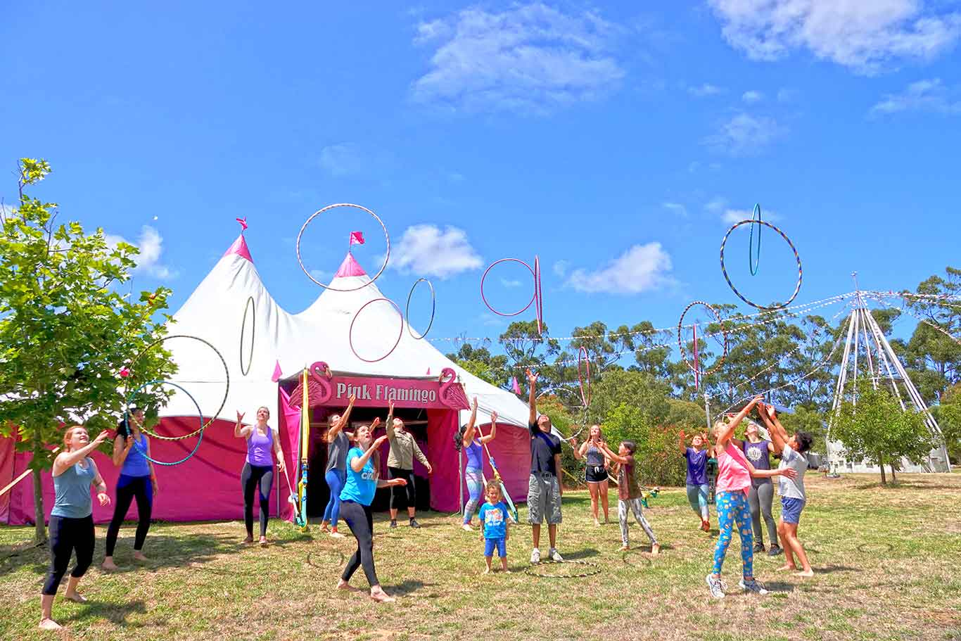 Hula Hooping outside the Pink Flamingo at Lunar Circus International Training Project